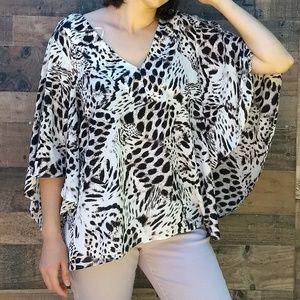 Jennifer Lopez leopard print bell sleeves blouse